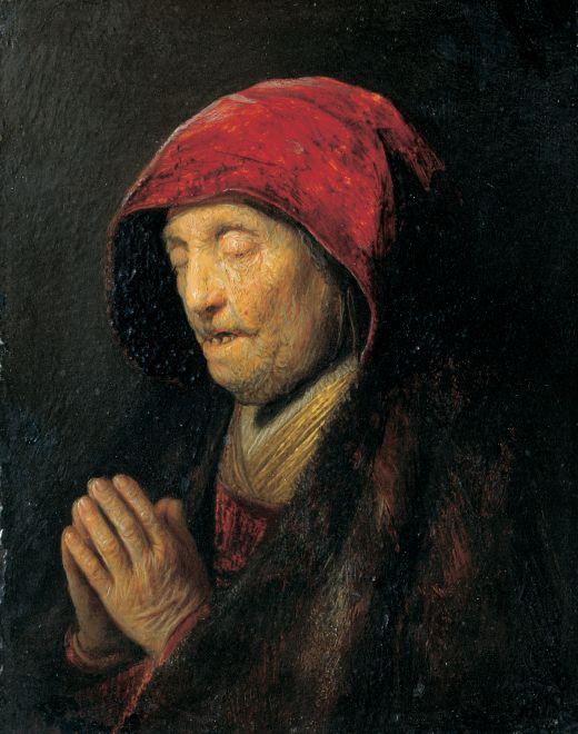 Mujer vieja orando